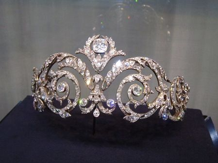 A belle epoque tiara, 1908, by Chaumet. Made for the Marquis de Talhouet, a classic scrolling foliate tiara, with large circular diamonds at the centre of each scroll and topped by a larger, cushion-cut diamond.: