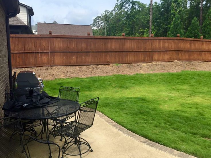 New fence and sod installed.