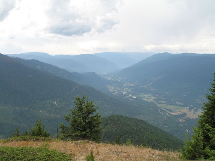 View of the Slocan Valley facing South over Lemon Creek taken from Skycastle Lookout.  Haze is from fires that were burning in Washington State that summer.