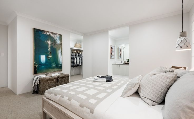 The master bedroom is luxurious with huge walk-in robe and ensuite with Caesarstone benchtops, double sinks and double shower