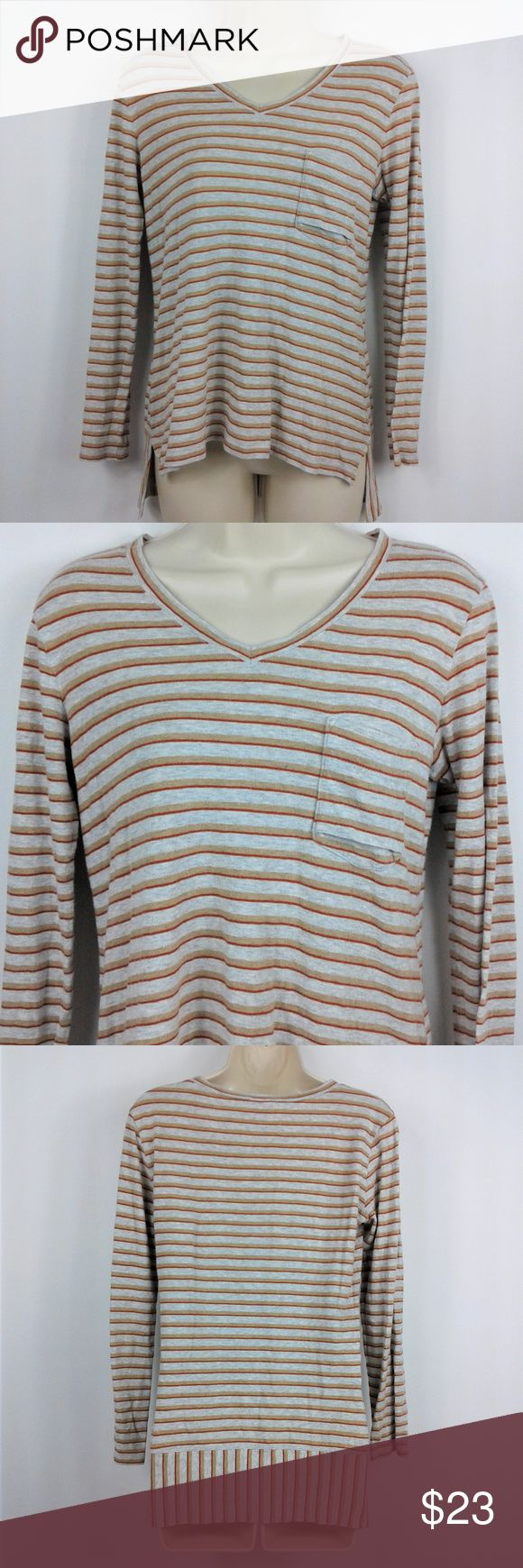"CAbi Skipper Tee Long Sleeve High Low CAbi Skipper Tee Long Sleeve High Low Striped # 3055 Sz Small 100% Cotton Pocket  Skipper Tee #3055 long-sleeved V-neck. High low hem. Horizontal stripes of grey, camel, and orange. Complimentary vertical stripes in back. Front pocket  Size: Small  Measurements  Chest (pit to pit): 17""  Height (back of collar to hem): Front: 21"" Back: 25""  Sleeve: 21"" CAbi Tops Tees - Long Sleeve"