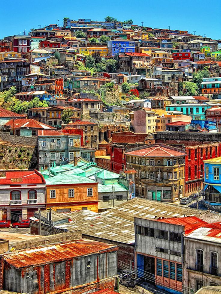 Valparaiso, Chile. Only 70 miles northwest of capital Santiago, Valparaiso is Chile's main port and known for its bohemian, artistic vibe, and lovely vistas. | 21 Most Colorful and Vibrant Places In The World. http://bzfd.it/UWMQFx