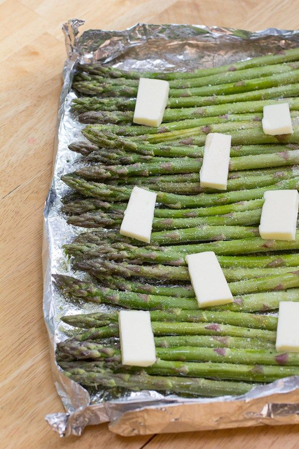 Seasoned1 pound asparagus, ends cut off or peeled, and washed ½ teaspoon garlic salt ½ teaspoon onion powder 1 tablespoon olive oil 2 tablespoons butter, salted INSTRUCTIONS  Report this ad  Fold up a little foil tray with raised sides. You can also use a small baking pan for this, just make sure it has sides and is secure. Cut off the tough ends of the asparagus, and wash well. Let dry, and the toss with olive oil. Season evenly with seasonings, and lay in a single layer on ba Grilled…