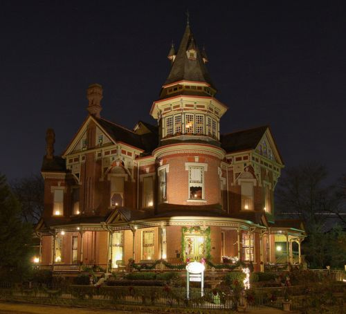 This is a beautiful Victorian (apparently B&B now), lit up for the holidays with candles in every window.  The 3rd floor room in the tower, with wall-to-wall windows, is amazing; wonder what this room is used for?