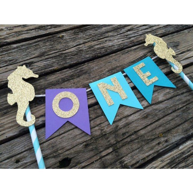 New mermaid cake topper. This would look adorable for a photo shoot session with a smash cake. #etsy #etsyshop #etsyseller #mermaidparty #caketopper #undertheseaparty #firstbirthday #party #partysupplies #papergoods #blueoakcreations #crafts #craftymomma See More Goodies at: www.blueoakcreations.com