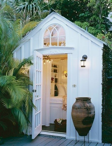 Garden shed turned reading nook. All-white, tropical island inspired. More ways to revamp your garden shed at www.redonline.co.uk