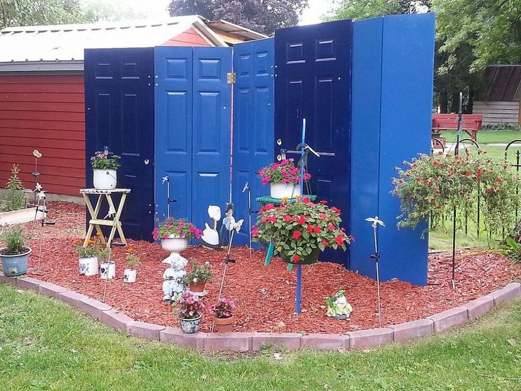 LOVE This: Privacy Fence Made From Doors   Hometalk