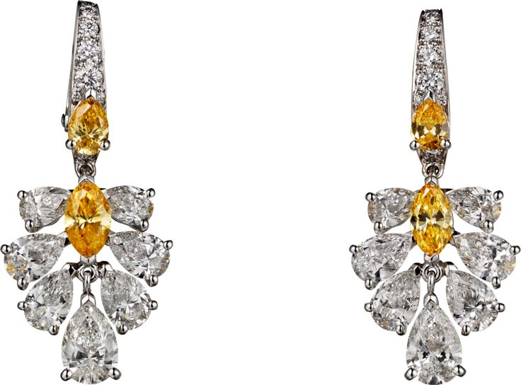 CARTIER Earrings: platinum, orange-yellow diamonds, yellow diamonds, and white diamonds.