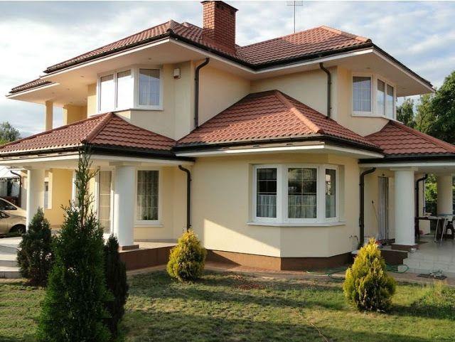 Elewacje Zuzzy: Czerwone dachy, białe okna - klasyka