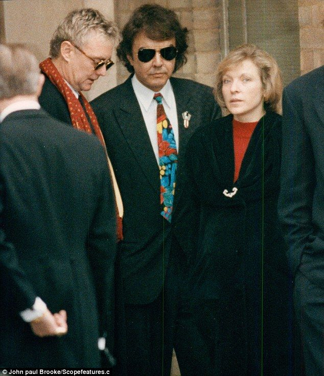 Article is really a life long love story between Mary & Freddie.....(Mary at Freddie Mercury's funeral with Queen drummer Roger Taylor and Dave Clark)