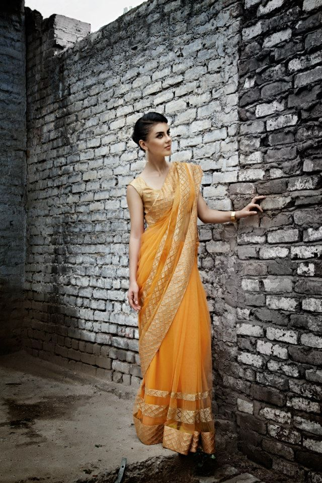 Orange Sari —Love this color, it complements South Asian skin tones so well! #SouthAsianCouture #Sari