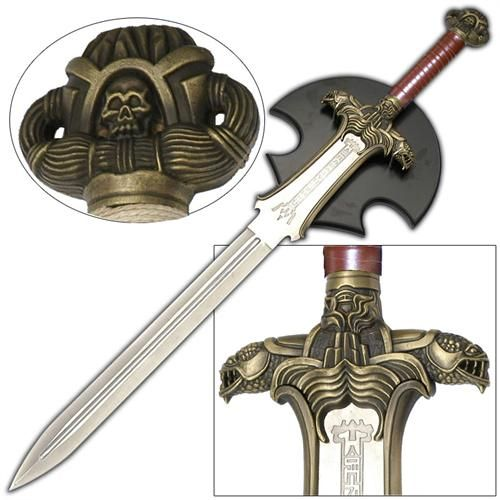 This is the sword of Conan. Although, Conan has had many swords this was the sword that began it all. The sword is very well made with extreme details, down to the grain of antlers and texture of the Elk Skull. This is an essential piece to add to any fantasy collection. The sword includes a black end cap and Wooden Wall Mount Plaque. #conanthebarbarianatlanteansword