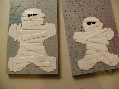 mummy made out of gingerbread man shape covered with white strips of paper - Halloween Mummy Crafts