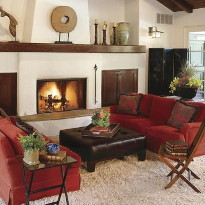 Rev Up Your Living Room with Red. Punctuate a neutral color scheme with strong statement pieces like these red sofas. The classic color pulls together the adobe-style architectural elements with eastern accents like the chinoiserie screen.