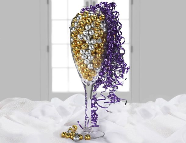 Wine Glass Centerpiece - also can fill with pearls; wrapped chocolate candy | paigespartyideas