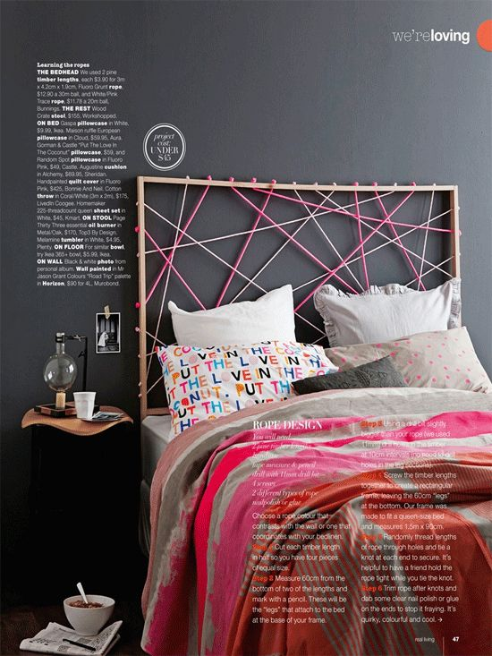 Cool DIY headboard idea: wooden frame with drilled holes and a bit of fluro bungee rope.