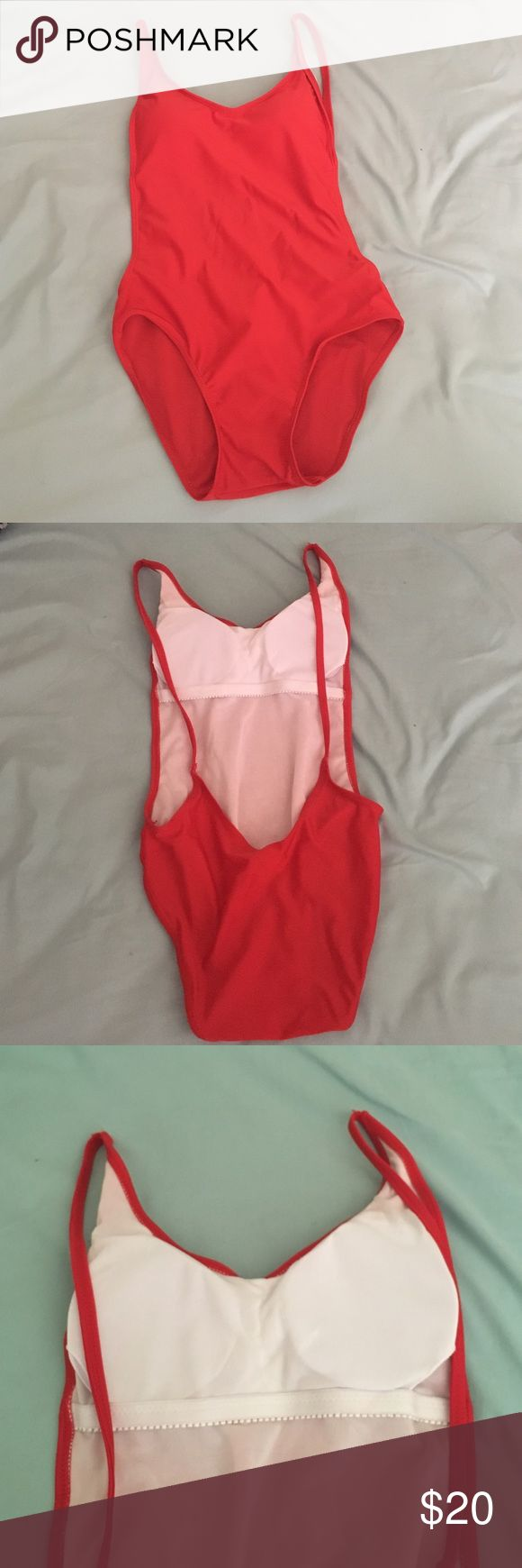 Red Open Back Bathing Suit This is a beautiful, new bathing suit. It's a reposh it unfortunately doesn't fit me. Just trying to get my money back! It's a beautiful red color, think Baywatch-type bathing suit. I've only tried this on while wearing underwear, really wish it would fit me. Last picture is a similar style. Swim One Pieces