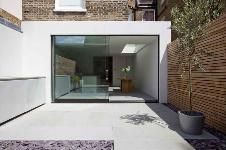 Shandon, Lambeth by Studio Octopi won ?Best Use of Landscaping? for its approach to inside and outside spaces. The sliding door subtly divides house and garden, while a sandstone floor extends outwards to form a terrace. Photo: Julian Love Photography
