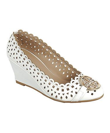 Destination Wedding Ideas: White Perforated Doris Wedges. Add more embellishments or as-is. Beauty beneath your wedding dress and sand and beach worthy! Brides' maid shoes, amazing price!    Chic and sexy for your wedding day, all-inclusive wedding or cruise wedding celebration by PJ 503-260-0557 #allweddingsallowed #specialeventsbypj #allgroupsallowed #zulilyfinds