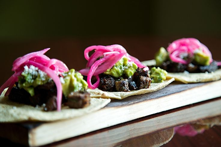 The menu at Tapas 51 unites flavors from across Latin America. The coffee and chili-crusted brisket tacos pictured are served with local queso fresca, charred onion chimichurri, and avacado.
