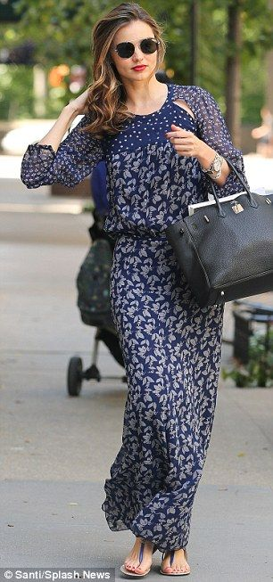 Out for a stroll: Orlando Bloom's ex wife covered up with floor length, blue…