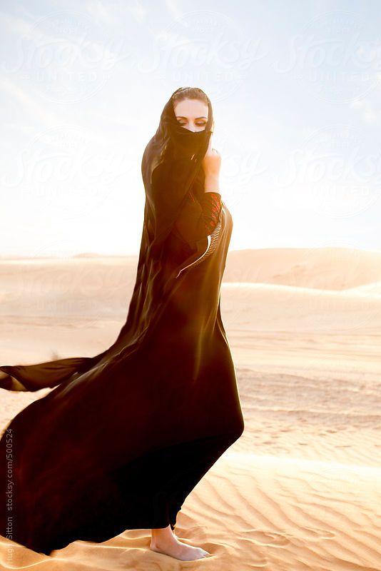 Arabian woman wearing traditional hijab costume. Dubai desert. United Arab Emirates. by Hugh Sitton