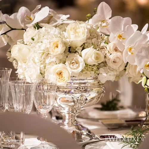 Metal with beige devote and soft white flower arrangements
