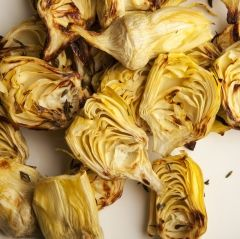 Roasted Artichoke Hearts - These simple roasted artichokes are an easy, tasty side dish, a great topping for pizza, or delicious tossed into a salad with some olives. When fresh artichokes are in season, you can make this using the small Italian artichokes. See our how-to article for preparing artichokes.
