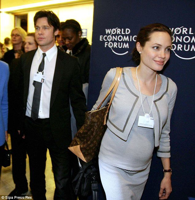 Humanitarian couple: Brad and a very pregnant Angelina attended the World Economic Forum i...
