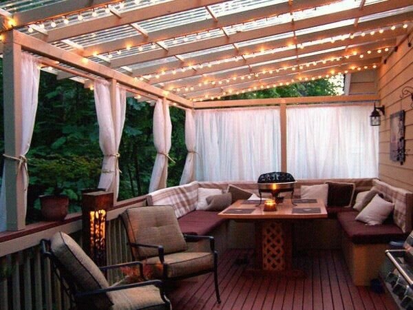 Create some ambiance on your deck with some overhead string lighting. Simple and Effective. I've always loved this look.