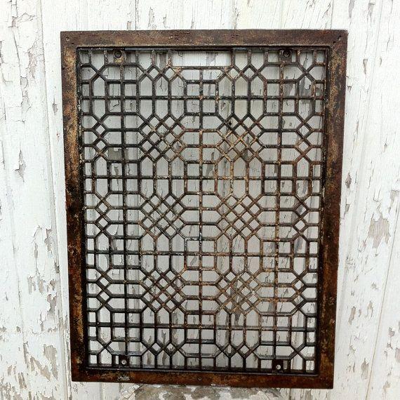Antique cast iron window grille.
