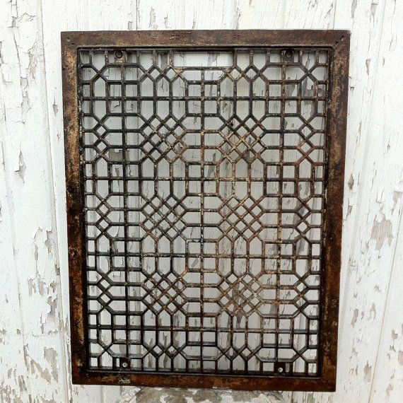 Antique cast iron window grille.