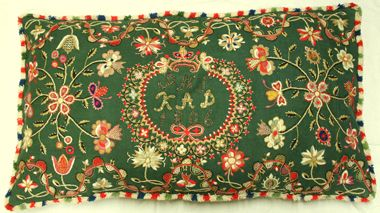 Beautiful embroidery on bright green background.