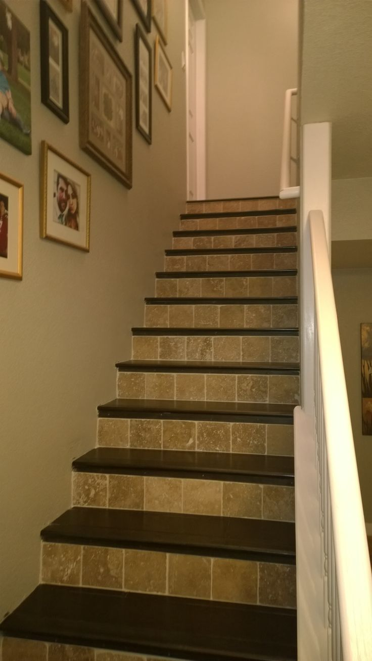 Dark wood floor stairs with travertine risers