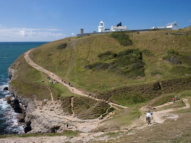 The track leading to Anvil Point Lighthouse at Durlston Head on the Isle of Purbeck along the Jurassic Coast in Dorset.