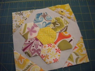 Pieced block with hexagon flower.  Add some batting to make the hexagons pop.