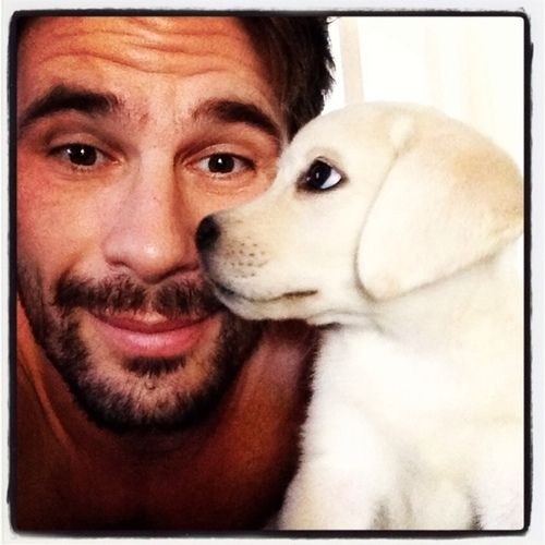 "Okay ... I have a weakness for Manuel Ferrara. I admit it. He's sexy as ""all get the fu$k out of here"". I know ... get in line, right!  Don't know why but this pic with the puppy is my absolute favorite. Something about a guy with his beloved four legged buddy gets me all ""gooey"" every time. Now that is some sexy sh*t !!! V. Shaw"