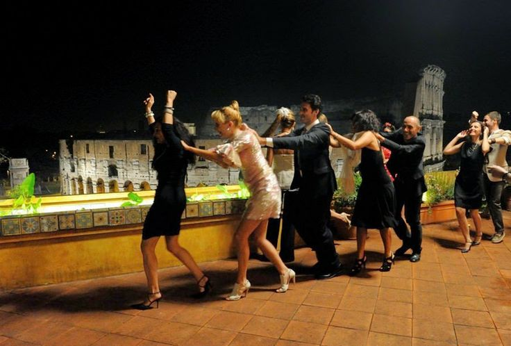 The Great Beauty … conga line with the Colosseo in the background.