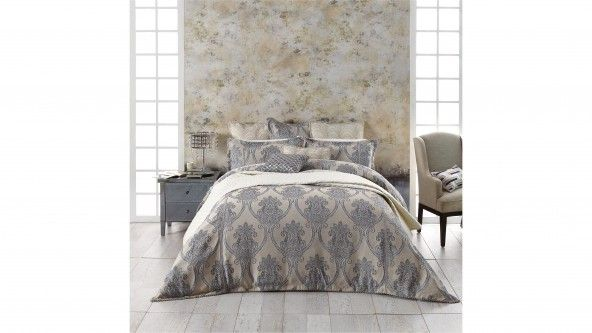 Create an Italian-inspired summer style for the bedroom with the beautiful Mirano Linen Quilt Cover Set. Large scale, highly stylised floral motifs in blue and white are woven into a textured, natural look background with two vertical rows of decorative braid on the front. A tailored self-flange with twisted two-tone cord trim completes the look.