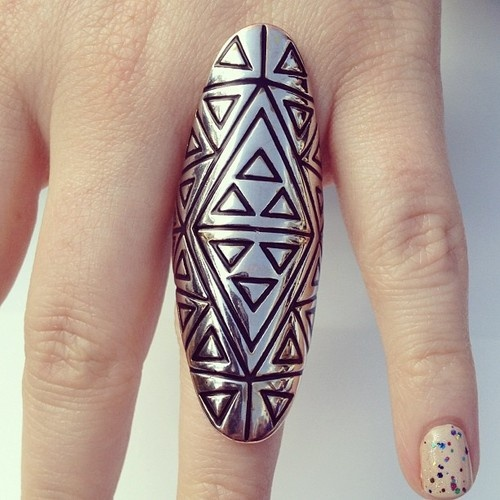 GEOMETRIC COMPANION  Step into the future with a geometric silver statement ring as your plus one.
