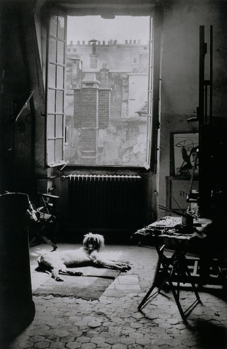 "L'Atelier de Picasso [Picasso's Studio]. Rue des Grands-Augustins, Paris 6e, May 9, 1944. From Brassaï ""The light is marvelous today. It sets to vibrating the roof-tops, the chimneys, the section of wall."""