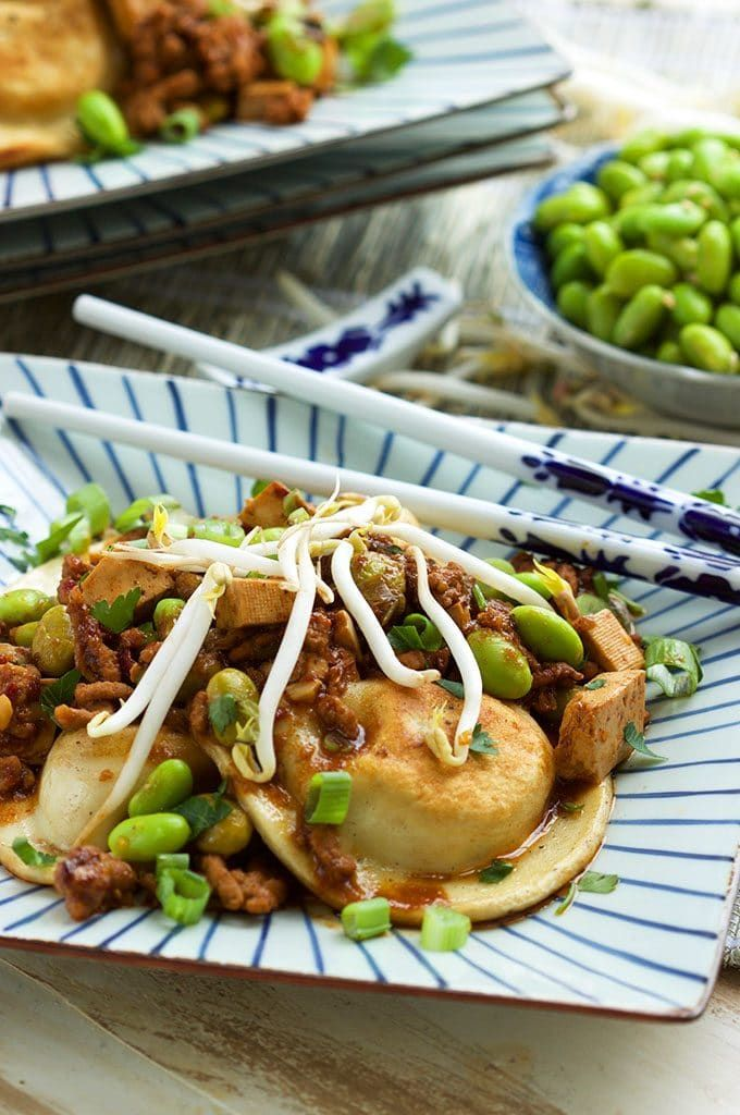 Fast and easy, this Szechuan Style Pierogi recipe is out of this world delicious! Full of flavor with a little heat, this will be a family favorite for every weeknight dinner. | @suburbansoapbox