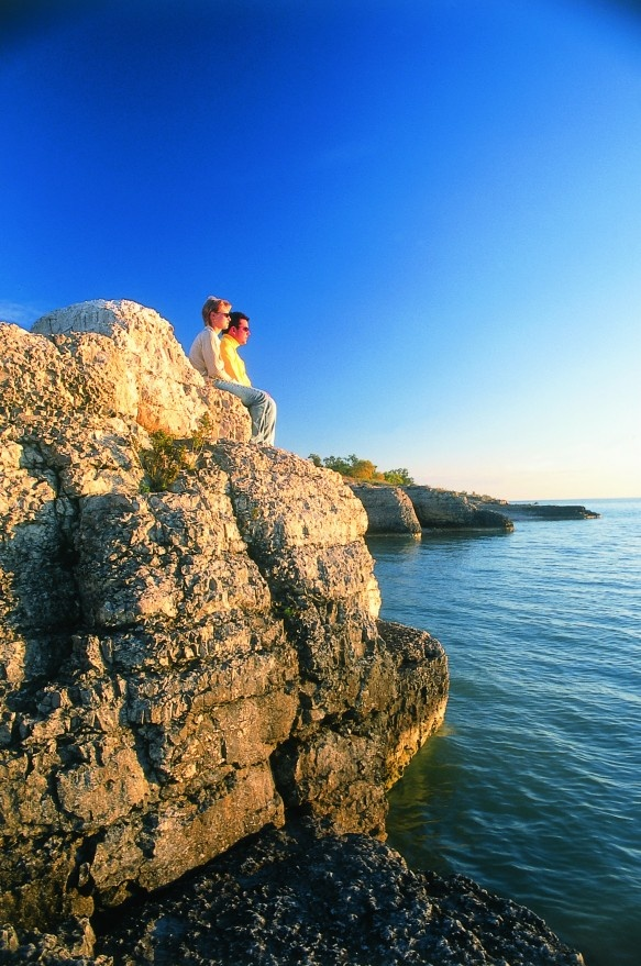 Hiking trails offer views of the forty-foot cliffs jutting into the water on the shores of Lake Manitoba.