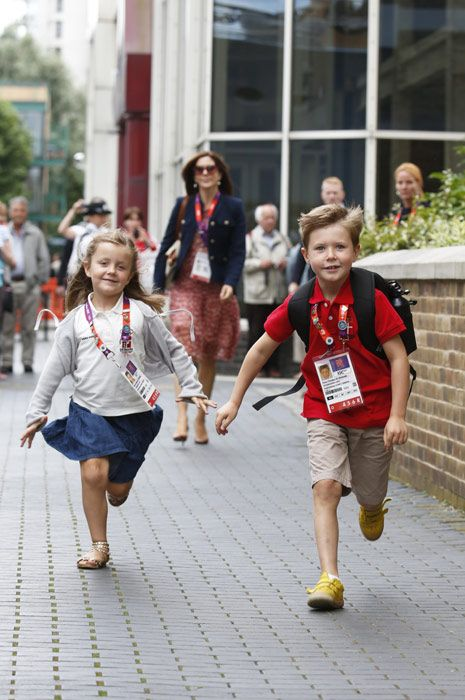 The Crown Princess of Denmark watches her children, Princess Isabella and Prince Christian, play whilst in London for the Olympics