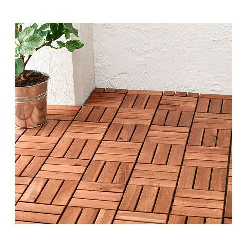 Ikea RUNNEN Wood Decking - wood tiles that lay down over your existing concrete. Pretty, but needs to be re-glazed every year.