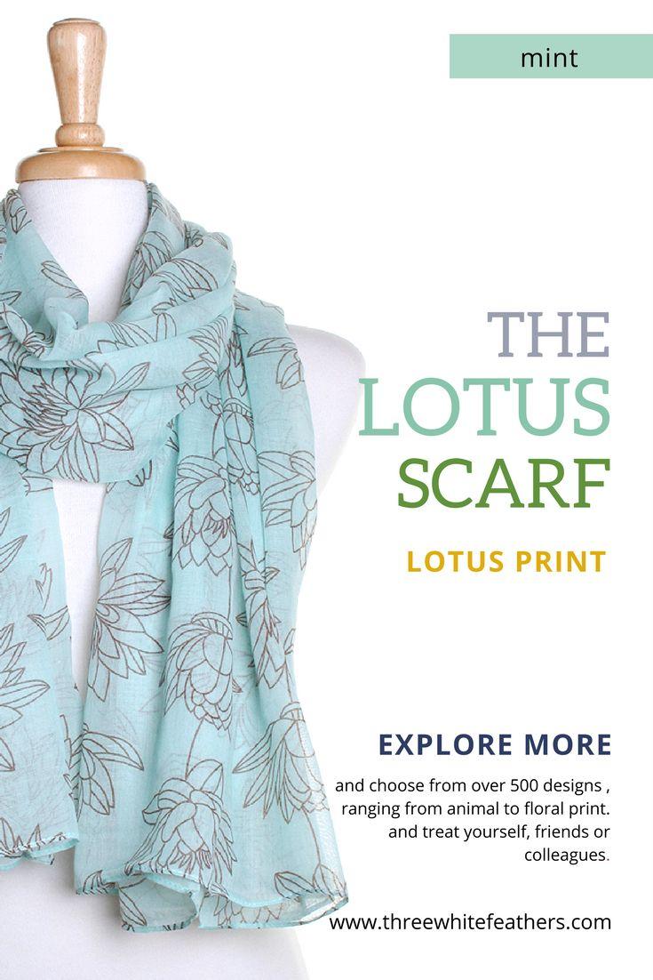 Pastel mint scarf with lotus flower print in brown.