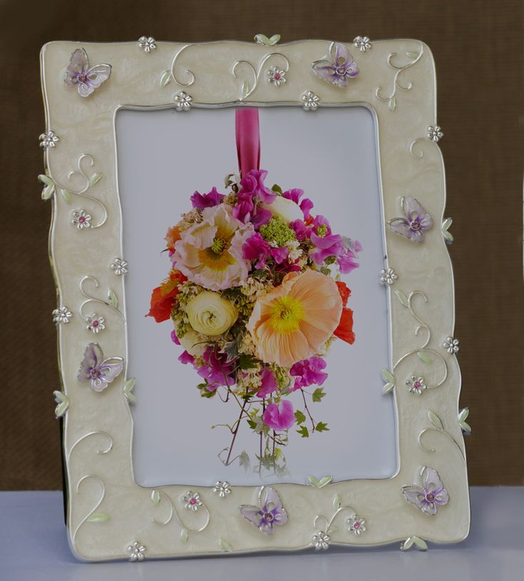 Photo Frame with Big Butterfly Border The gorgeous frame with a feminine touch of flowers and butterflies, gives it a designer look to cherish and treasure pictures that will take you down the memory lane.  http://www.thedivineluxury.com/product/Photo-Frame-with-Big-Butterfly-Border.html