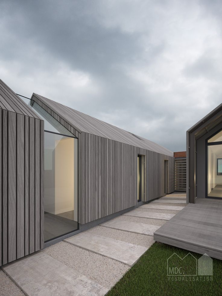 Cedar clad single storey new build house with glass link and concealed gutter…