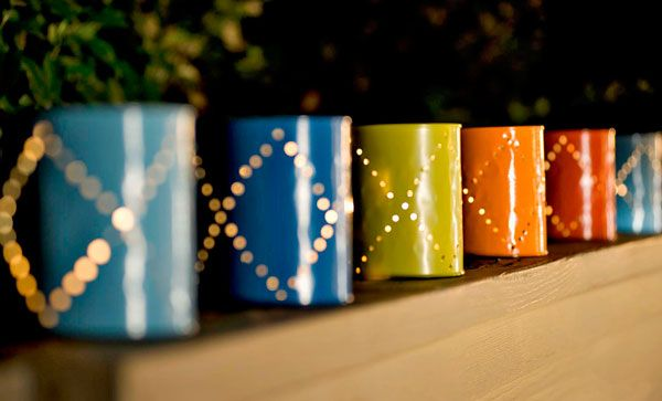 Paint empty soup cans bright summer colors, poke holes, and add a candle inside for an inexpensive lighting option.