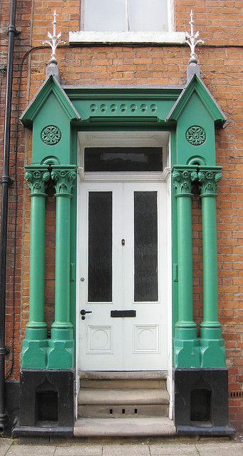 White entry door with emerald green features- beautiful Sculcoates, East Yorkshire, England.